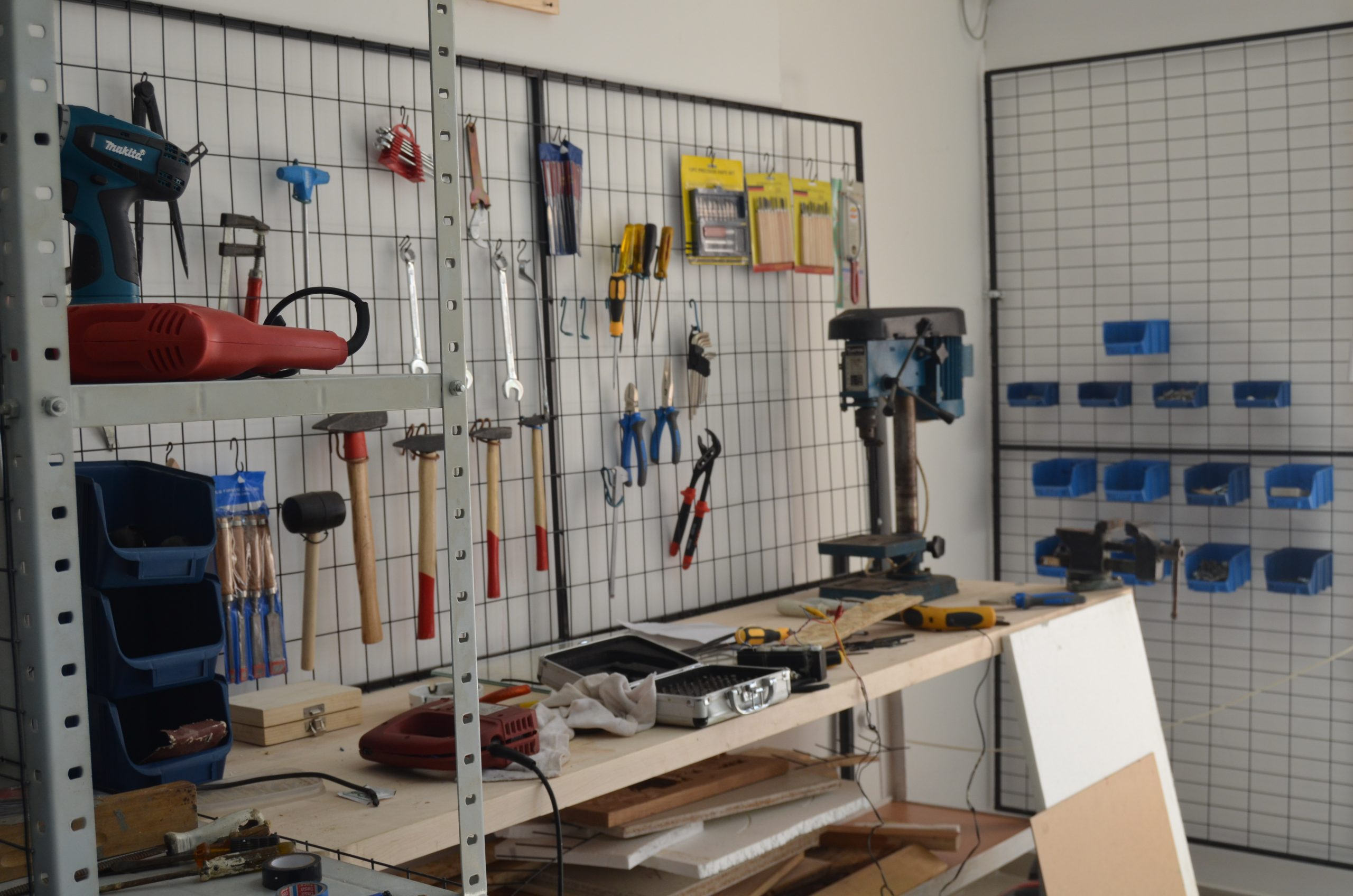 Workshop with tools hanging from the wall.