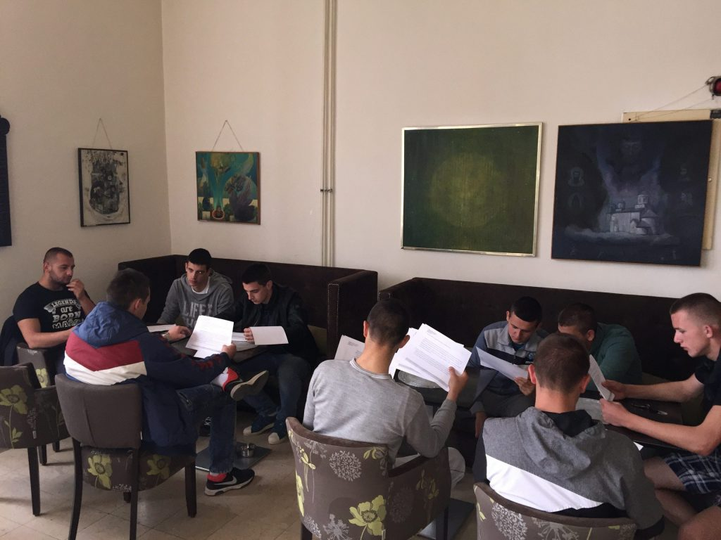 Eight young people sitting indoor and studying.